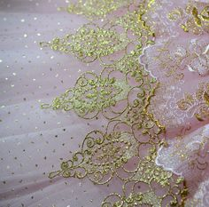 Beautiful use of lace over enhanced sparkle tulle.