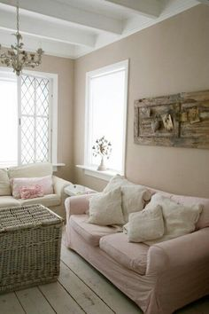 I like the use of light pink & pastels for a beach cottage.