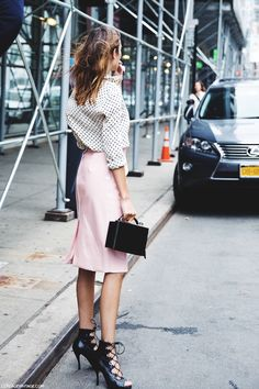 Alexa Chung // polka dot top, pink skirt, box bag & lace-up boots #style #fashion #markcross #celebrity #streetstyle
