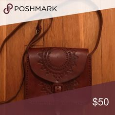 Mexican Tooled Handmade Leather Cross Body Bag In basically new condition. Handmade in Mexico 🇲🇽. All natural leather hand tooled. Measurements and more information/ pictures will be updated soon 😊 Bags Crossbody Bags