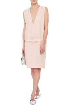 This **Equipment** dress features an effortless slip silhouette with a drop waist belt for easy chic.