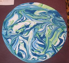 Space Theme: Shaving Cream Marbleized Earth (or change colors for other planets)  ... Cub Scouts in Space Day Camp activity.  The Cub Scouts LOVED this activity last year.
