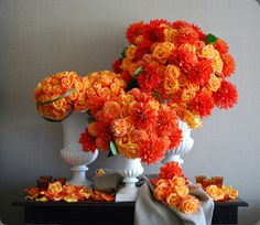 A trio of flaming orange flower arrangements by  collage design la #orange #flowerarrangement #centerpiece