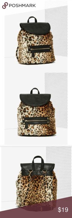 NWT Faux Fur Leopard Cheetah Mini Backpack Purse Brand new with tags. Has leather on top, a front zipper, and is made of a soft fix fur material. It's a mini backpack but not very small. Originally $69 from Nasty Gal :) Nasty Gal Bags Backpacks