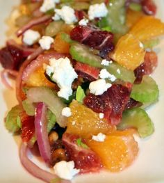Blood and navel orange celery salad with pecans red onions and goat cheese. Who says salad needs green leaves?! #citrus #bloodorange