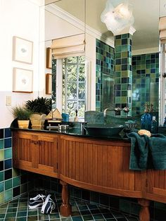 Wish I could see more of this #bathroom but I really like the mix of blue-green tiles and wood together! #home #decor