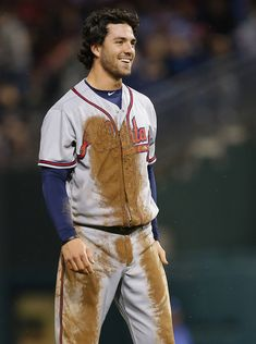 Dansby Swanson Photos Photos - Dansby Swanson #7 of the Atlanta Braves is covered in mud after diving back several time into first base during the fifth inning against the Philadelphia Phillies in a game at Citizens Bank Park on April 22, 2017 in Philadelphia, Pennsylvania. - Atlanta Braves v Philadelphia Phillies
