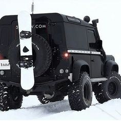 Land Rover Defender 90 Icon. Black  snowboarding.