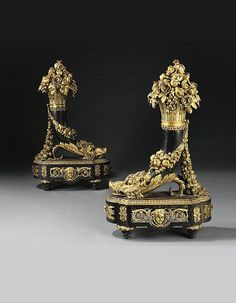 A LARGE PAIR OF FRENCH ORMOLU AND PATINATED BRONZE CHENETS