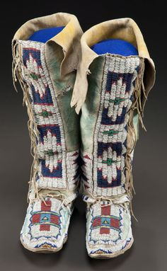 American Indian Art:Beadwork and Quillwork, A PAIR OF CHEYENNE BEADED HIDE HIGHTOP MOCCASINS. c. 1890. ...