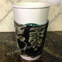 """This adorable and functional coffee """"cozy"""" is one of a kind!  Recycling the cardboard sleeve from a local coffee shop, it is sandwiched in between a piece of denim and a Hawaiian shirt with a retro leaf print.  Wraps around securely with Velcro.  Surely to let your friends know that you """"hang..."""