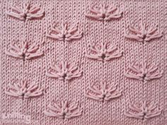 Little Cornflower on a stockinette background - http://www.knittingstitchpatterns.com/2014/11/cornflowers.html