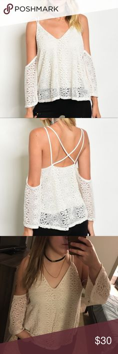 NWT White Lace Cold Shoulder Blouse Off Shoulder Really cute top! Runs a little small, I would size up.    The back is super cute!  Keywords: Cream, lacy, spaghetti strap, strappy Tops Blouses