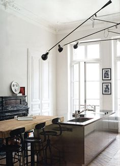 A kitchen Inspiration with 3 of the 265 wall lighting fixture from #FLOS. Nice things in multiples, a winning formula!