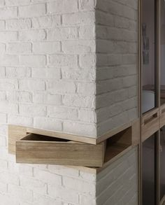 Timber swivel drawer within a wall