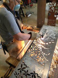Plasma cutting a new Corten steel panel.