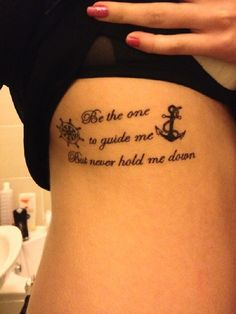 A simple and small anchor and ship wheel tattoo. Perfect pair of tattoos when you want to add your very own special quote with it.