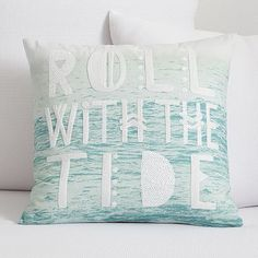 Kelly Slater Roll With The Tide Pillow Cover // A beachy headline pops against the oceanic image on this organic canvas pillow cover. Exclusively designed with 11-time world surfing champ Kelly Slater, it brings authentic surfer style to your room