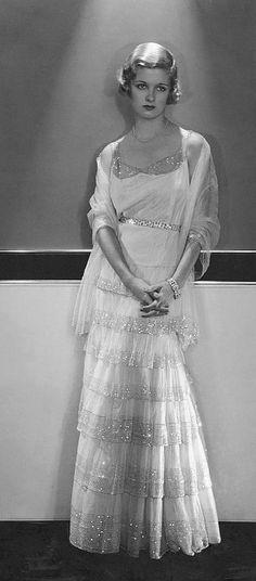 Actress Joan Bennett wearing a Chanel evening gown, ca 1930.