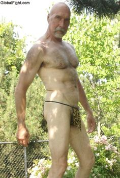 older hairy silver daddy wearing tiger leopard thong