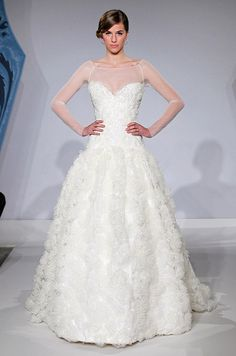 A wedding dress with sheer sleeves from Mark Zunino, Spring 2013