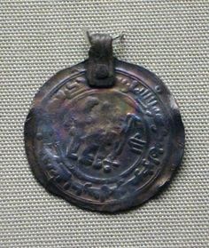10th C. Gotland. Silver coin pendant; Samanid dirham; riveted suspension loop of ribbed sheet.