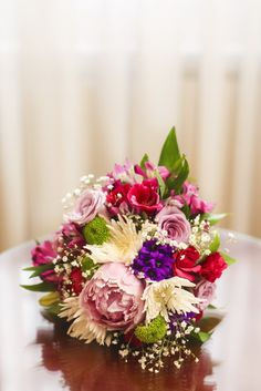 liking the combination of strong colors for the brides boquet