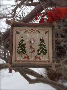 Completed Primitive cross stitch Cardinal Winter by Rishastitchery