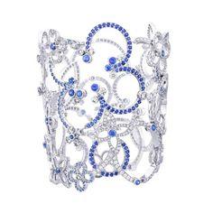 Louis Vuitton Haute joallerie. Manchette en or gris, 644 diamants et 519 saphirs bleus