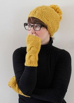 Ravelry: Warm winter pom pom hat with fingerless gloves pattern by Anna & Heidi Pickles