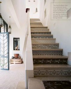 Obsessed. Stairs, stencils, stone, herringbone doors, decor, color scheme. Love it all.