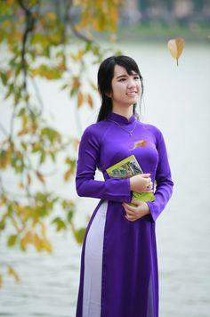 Hanoi Girl wearing Traditional Custom named Ao Dai ( Ao Zai)