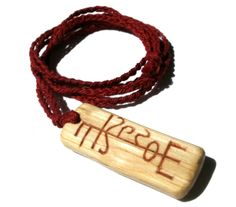 Runestave to Thundur - The Witch of Forest Grove  Thundur is a name of Odin referring to his hanging from the world tree to gain wisdom and knowledge.Carved from Oak wood, painted with red ochre, and strung on a hand braided red cotton cord.