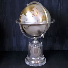 Large pivoting globe mounted in silver and resting on a fluted rock crystal base the concentric silver ring engraved with the twelve signs of the Zodiac as well as twelve names and countries, Cartier, Paris circa 1935