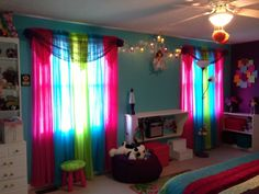Tween bedroom.  Live the different colors of curtains..