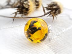 #Necklace dried flowers arnica montana sphere transparent lens real flower necklace herbarium botanical jewelry pressed wild forest flower.  Pendant size: ball is 24 mm dia ... #etsy #artisanbot #bestofetsy #artfire #etsyretwt #gift #necklace #pendant