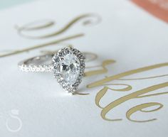 Nothing says elegance and love quite like this perfect pear shaped halo engagement ring from Sylvie Collection!