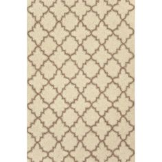We've taken neutral to the next level with our best-selling, vintage-style wool area rug in an Old World tile-inspired pattern.