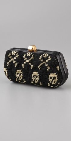 Rebeccca Minkoff. Skulls take it back... almost packman style.