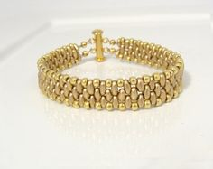 GOLD CUFFS AND BANGLES PINTEREST | Gold beaded narrow cuff bracelet by lizardpoint | super duo - twin ...
