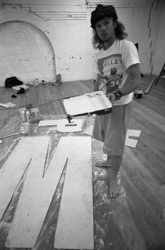"""Bassist Jeff Ament did the artwork for the """"Ten"""" photo shoot, creating and painting large letters to spell Pearl Jam. (Lance Mercer/1991)."""
