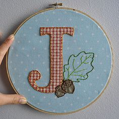 Great idea... hang embroidery while still inside the hoop!