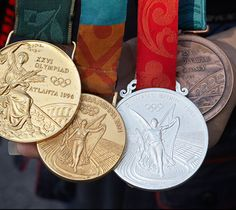Kim Rhode's Olympic Medals | NRA Women's Network Gallery Kim Rhodes, Olympic Medals, Shooting Sports, Top Gun, Self Defense, Olympics, Personalized Items, Gallery, Olympic Shooting