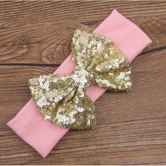 """Light Pink headband with big gold sequin 5"""" bow.     Will match our light pink and gold polka dot outfits.     Shop our store for matching outfits and other accessories.     >Top Quality Children's Headbands    >Fits infants to adults.     >In Stock/Ready To Ship 
