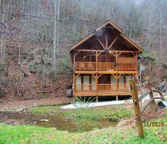 Original gatlinburg log cabin honeymoon cabin rental for Creekside cabins in pigeon forge tn