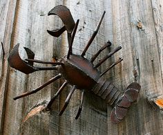 Makes me think of beach houses, good eats and great company! Handmade lobster sculpture. Made with reclaimed metal.  https://www.etsy.com/listing/152991838/metal-sculpture-wall-art-lobster?ref=shop_home_active