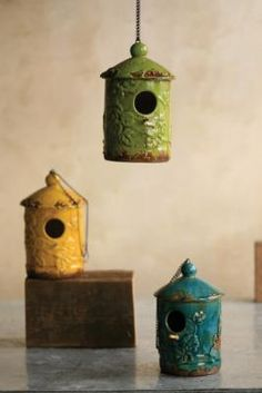 Ceramic bird houses in tropical colors. [At West End]***Research for possible future project.