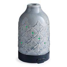 Create a spa-like experience in the comfort of your home with the Jasmine Ultrasonic Essential Oil Diffuser. Textured ceramic quatrefoil design features multicolor LED lighting and has 2 mist modes to blend oils for seamless, aromatic relaxation. Jasmine Essential Oil, Aromatherapy Benefits, Quatrefoil Pattern, Bohemian Pattern, Candle Warmer, Therapeutic Grade Essential Oils, Essential Oil Diffuser, Fragrance Oil