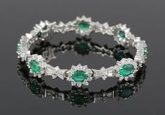 Ladies' bracelet, 14k white gold with diamonds and emeralds, having 6.40 total emeral carats and 5.14 total diamond carats.