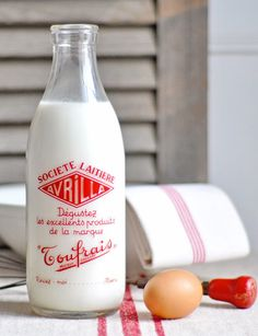 Vintage French milk bottle with a classic vintage tea towel.